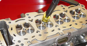 Valve seat angles recut by hand
